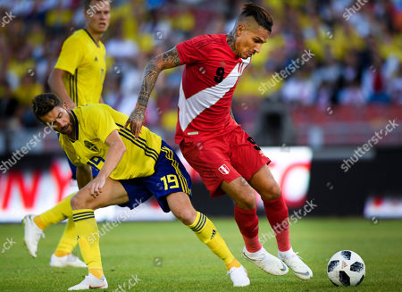 Sweden's Marcus Rohden (L) fights for the ball with Peru's Paolo Guerrero during the international friendly soccer match between Sweden and Peru at the Ullevi stadium in Gothenburg, Sweden, 09 June 2018.