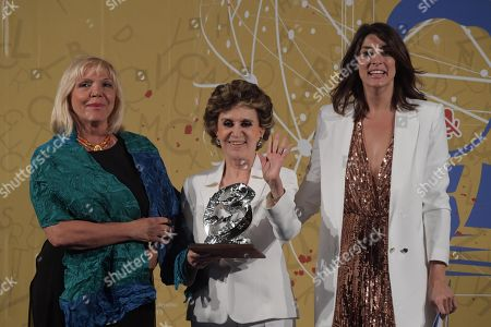 Stock Photo of Franca Leosini (C), journalist of the year for Television, receives the award from Paola Balducci (L), Superior Council of Magistrates next to TV presenter Elisa Isoardi during the XXXIX edition of the Ischia International Journalism Prize in Lacco Ameno, Ischia island, Italy, 09 June 2018.