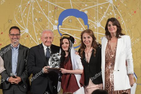 (L-R) The Director of ANSA Luigi Contu, Campania Region's President Vincenzo De Luca, Iraqi Yazidi photographer Zina Salim Hamu, the winner of the Ischia Prize for Human Rights, the Head of the project 'Photographic techniques to empower Yazidi girls', Shayla Hessami and Italian TV presenter Elisa Isoardi during the XXXIXth edition of the Ischia International Journalism Prize in Lacco Ameno, Ischia island, Italy, 09 June 2018.