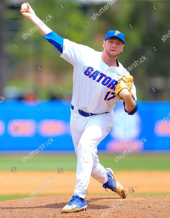 Florida pitcher Michael Byrne warms up between innings against Auburn during an NCAA Super Regional college baseball game, in Gainesville, Fla. Florida defeated Auburn 8-2