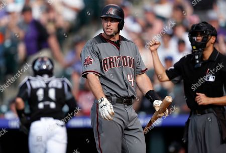Paul Goldschmidt, Gabe Morales, Tony Wolters. Arizona Diamondbacks' Paul Goldschmidt, center, reacts after striking out with two runners on base against Colorado Rockies starting pitcher Chad Bettis during the second inning of a baseball game, in Denver. Rockies catcher Tony Wolters heads back to the dugout as home plate umpire Gabe Morales, back right, signals that Goldschmidt is out