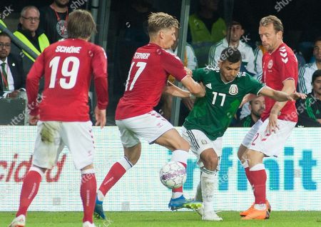 Denmark's Jens Larsen (2L) vies for the ball with Mexico's Jesus Manuel Corona (2R) during the International Friendly soccer match between Denmark and Mexico in Brondby, Denmark, 09 June 2018.