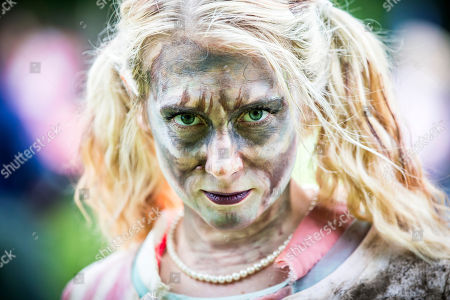 Knaresborough UK. Helen Easton who is competing in the Knarsborough bed race today dressed as a zombie. Knaresborough bed race is taking place today in the town of Knaresborough in Yorkshire. The race first held in 1966 is part fancy dress & part gruelling time trial over a 2.4 mile course ending with a swim through the River Nidd.