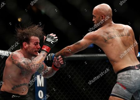 Mike Jackson, right, lands a punch on CM Punk during a welterweight UFC 225 Mixed Martial Arts bout, in Chicago
