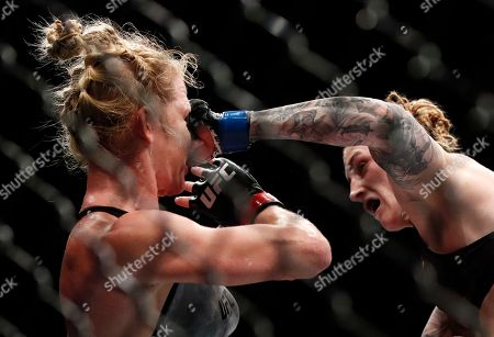 Megan Anderson, right, lands a punch on Holly Holm during their women's featherweight UFC 225 mixed martial arts bout, in Chicago