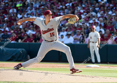 South Carolina pitcher Adam Hill throws to an Arkansas batter during the first inning of an NCAA college baseball tournament super regional game in Fayetteville, Ark