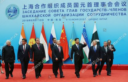 Leaders of member states of Shanghai Cooperation Organization (SCO) Chinese President Xi Jinping (4-R), Russian President Vladimir Putin (5-R), Kazakh President Nursultan Nazarbayev (3-R), Tajik President Emomali Rahmon (3-L), Uzbek President Shavkat Mirziyoyev (2-R), Kurgyz President Sooronbay Jeenbekov (2-L), Indian Prime Minister Narendra Modi (L), Pakistani President Mamnoon Hussain (R) walk to their first working session during the Shanghai Cooperation Organization (SCO) summit 2018 summit in Qingdao, China, 10 June 2018. The 18th Shanghai Cooperation Organization Summit will be held in Qingdao from 09 to 10 June 2018.