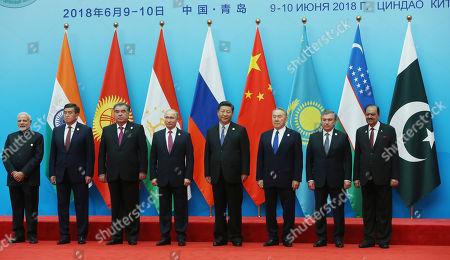 Leaders of member states of Shanghai Cooperation Organization (SCO) Chinese President Xi Jinping (4-R), Russian President Vladimir Putin (5-R), Kazakh President Nursultan Nazarbayev (3-R), Tajik President Emomali Rahmon (3-L), Uzbek President Shavkat Mirziyoyev (2-R), Kurgyz President Sooronbay Jeenbekov (2-L), Indian Prime Minister Narendra Modi (L), Pakistani President Mamnoon Hussain (R) pose for a photo prior to their first working session during the Shanghai Cooperation Organization (SCO) summit 2018 summit in Qingdao, China, 10 June 2018. The 18th Shanghai Cooperation Organization Summit will be held in Qingdao from 09 to 10 June 2018.