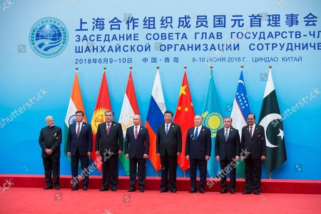 Imomali Rakhmon, Vladimir Putin, Xi Jinping, Nursultan Nazarbayev, Shavkat Mirziyoyev, Mamnoon Hussain. From left: Indian Prime Minister Narendra Modi, Tajikistan President Imomali Rakhmon, Russian President Vladimir Putin, Chinese President Xi Jinping, Kazakh President Nursultan Nazarbayev, Uzbekistan's President Shavkat Mirziyoyev and President of Pakistan Mamnoon Hussain pose for a photo prior to their talks at the Shanghai Cooperation Organization (SCO) Summit in Qingdao in eastern China's Shandong Province . China will seek to further promote its economic links with Central Asia during this weekend's summit of the China and Russia-dominated SCO