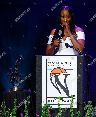 Stock Image of Chamique Holdsclaw pauses as she speaks during induction ceremonies into the Women's Basketball Hall of Fame, in Knoxville, Tenn