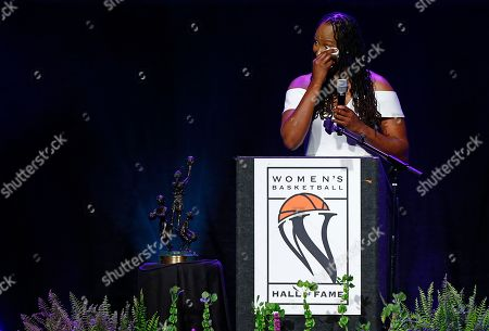 Chamique Holdsclaw pauses to wipe away a tears as she speaks during induction ceremonies into the Women's Basketball Hall of Fame, in Knoxville, Tenn