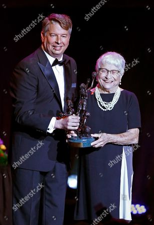 Dr. Rose Marie Battaglia, right, accepts an award from Eastman's David Golden during induction ceremonies into the Women's Basketball Hall of Fame, in Knoxville, Tenn