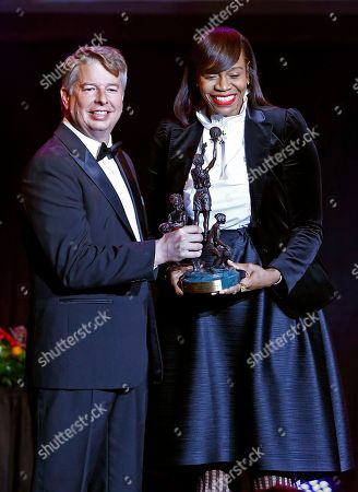 Tina Thompson, right, accepts an award from Eastman's David Golden during induction ceremonies into the Women's Basketball Hall of Fame, in Knoxville, Tenn
