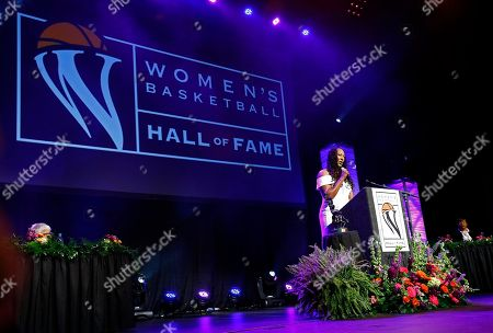Chamique Holdsclaw speaks during induction ceremonies at the Women's Basketball Hall of Fame, in Knoxville, Tenn