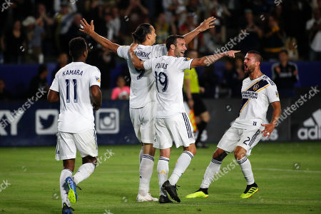 Zlatan Ibrahimovic, Ola Kamara, Chris Pontius, Perry Kitchen. LA Galaxy's Zlatan Ibrahimovic, center left, of Sweden, celebrates his goal with Chris Pontius, center right, Perry Kitchen, right, and Ola Kamara during the second half of an MLS soccer match against the Real Salt Lake, in Carson, Calif. The Galaxy won 3-0