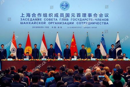 """Narendra Modi, Imomali Rakhmon, Vladimir Putin, Xi Jinping, Nursultan Nazarbayev, Shavkat Mirziyoyev, Mamnoon Hussain. Leaders of member states of the Shanghai Cooperation Organization (SOC) from left Indian Prime Minister Narendra Modi, Tajikistan President Imomali Rakhmon, Russian President Vladimir Putin, Chinese President Xi Jinping, Kazakh President Nursultan Nazarbayev, Uzbekistan's President Shavkat Mirziyoyev and President of Pakistan Mamnoon Hussain sign an agreements for the SOC summit in Qingdao in eastern China's Shandong Province, . Xi extolled free trade and criticized """"selfish, short-sighted"""" policies during the closely orchestrated gathering, standing in stark contrast with the G-7 summit that ended in disarray over trade tensions"""