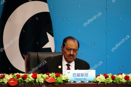 """Pakistan President Mamnoon Hussain looks during the signing ceremony for the Shanghai Cooperation Organization (SCO) Summit in Qingdao in eastern China's Shandong Province, . Xi extolled free trade and criticized """"selfish, short-sighted"""" policies during the closely orchestrated gathering, standing in stark contrast with the G-7 summit that ended in disarray over trade tensions"""