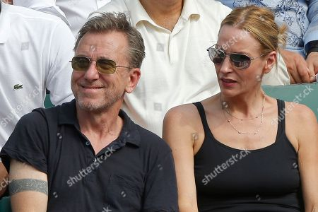 British actor and director Tim Roth and his wife Nikki Butler watch the men's final match of the French Open tennis tournament at the Roland Garros stadium in Paris, France
