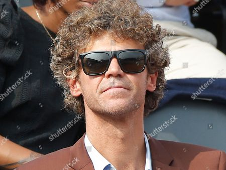 Three-time French Open winner Gustavo Kuerten of Brazil watches the men's final match of the French Open tennis tournament at the Roland Garros stadium in Paris, France