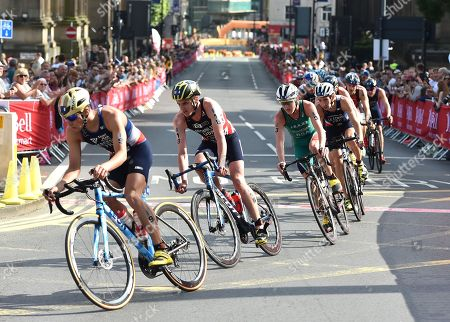 The Peloton races through the streets of Leeds with  Jonathan Brownlee GBR second from the front before he dropped out of the race