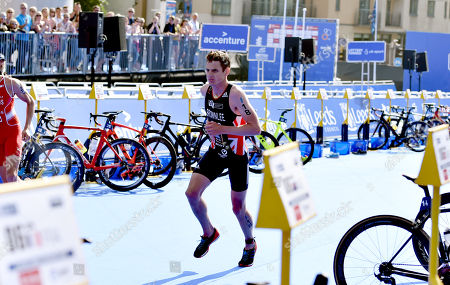 Jonathan Brownlee GBR on his own in transition after dropping back before he dropped out of the race