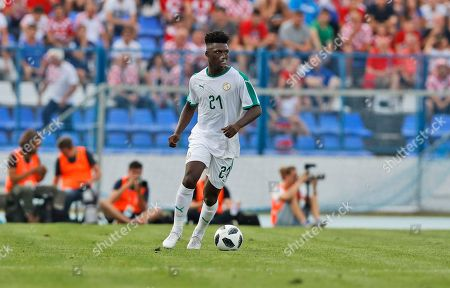 Senegal's Lamine Gassama controls the ball during a friendly soccer match between Croatia and Senegal in Osijek, Croatia