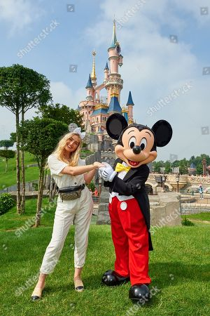 Perrie Edwards meets Mickey Mouse during the launch of Marvel Summer of Super Heroes at Disneyland Paris.