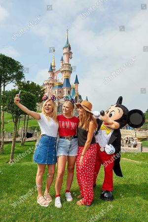 Tina O'Brien, Lucy Fallon and Samia Longchambon meet Mickey Mouse during the launch of Marvel Summer of Super Heroes at Disneyland Paris.