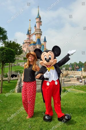 Samia Longchambon meets Mickey Mouse during the launch of Marvel Summer of Super Heroes at Disneyland Paris.