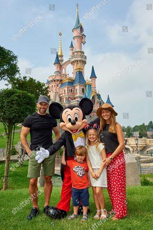 Sylvain Longchambon, Yves Joseph Longchambon, Freya Smith and Samia Longchambon meet Mickey Mouse during the launch of Marvel Summer of Super Heroes at Disneyland Paris.