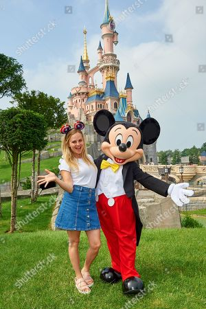Tina O'Brien meets Mickey Mouse during the launch of Marvel Summer of Super Heroes at Disneyland Paris.