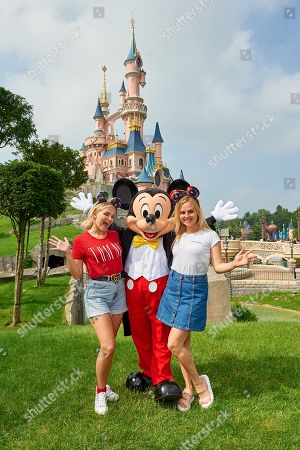 Lucy Fallon and Tina O'Brien meet Mickey Mouse during the launch of Marvel Summer of Super Heroes at Disneyland Paris.