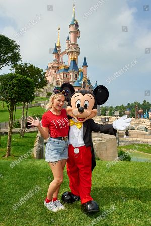 Lucy Fallon meets Mickey Mouse during the launch of Marvel Summer of Super Heroes at Disneyland Paris.