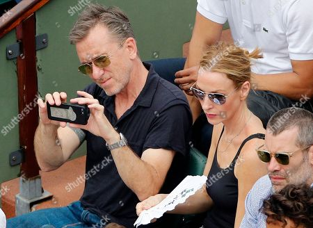 British actor Tim Roth and his wife Nikki Butler watch the men's final match of the French Open tennis tournament at the Roland Garros stadium, in Paris