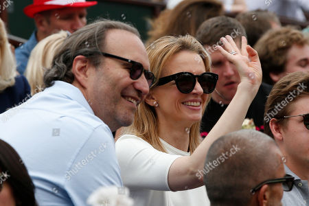 French telecommunication tycoon Xavier Niel and his companion Delphine Arnault, Christian Dior Couture's Assistant General Manager, attend the men's final match Spain's Rafael Nadal against Austria's Dominic Thiem in the French Open tennis tournament at the Roland Garros stadium, in Paris