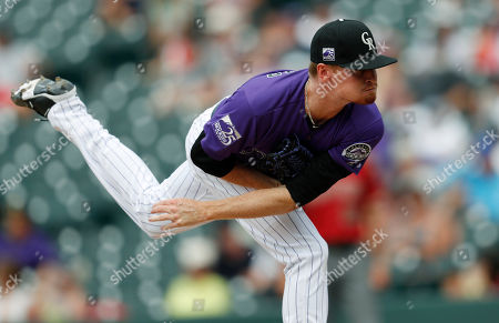 Colorado Rockies relief pitcher Sam Howard delivers to Arizona Diamondbacks' Ketel Marte in the ninth inning of a baseball game, in Denver