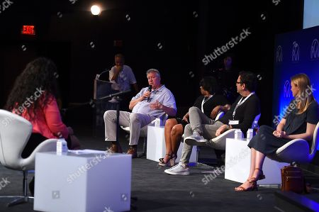 Chris Moore, Rose Catherine Pinkney, Michael Seitzman, Lynette Howell Taylor. Chris Moore, Rose Catherine Pinkney, Michael Seitzman and Lynette Howell Taylor listen to pitches during the second day of the 10th Annual Produced By Conference at Paramount Pictures on in Los Angeles