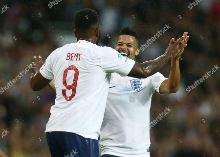 Darren Bent celebrates scoring the opening goal with Jeremy Lynch of England XI