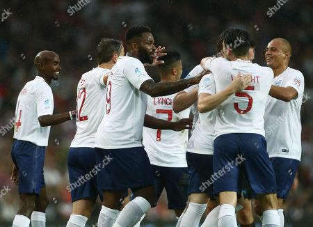 Darren Bent of England XI celebrates scoring the opening goal with his team-mates
