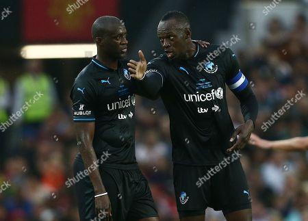 Usain Bolt of World XI and Yaya Toure