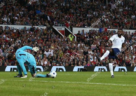 Darren Bent of England XI scores the opening goal