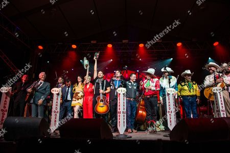 Del McCoury, Old Crow Medicine Show, Nikki Lane, Maggie Rose, Lanco, Riders in the Sky. Del McCoury, from left, Old Crow Medicine Show, Nikki Lane, Maggie Rose, Lanco, and Riders in the Sky perform during the Grand Ole Opry at the Bonnaroo Music and Arts Festival, in Manchester, Tenn