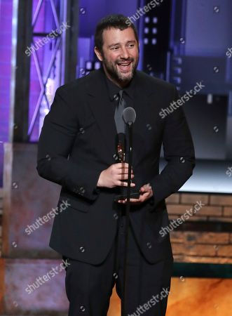 """Itamar Moses accepts the award for book of a musical for """"The Band's Visit"""" at the 72nd annual Tony Awards at Radio City Music Hall, in New York"""