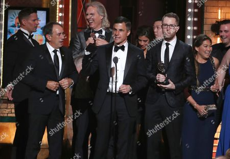 "Ken Davenport, center, and the cast and crew of ""Once On This Island"" accept the award for best musical revival at the 72nd annual Tony Awards at Radio City Music Hall, in New York"