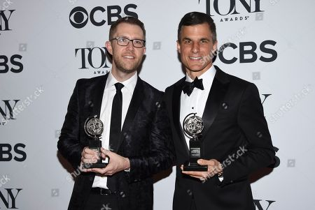 "Hunter Arnold, Ken Davenport. Hunter Arnold, left, and Ken Davenport pose in the press room with the award for best musical revival for ""Once On This Island"" at the 72nd annual Tony Awards at Radio City Music Hall, in New York"