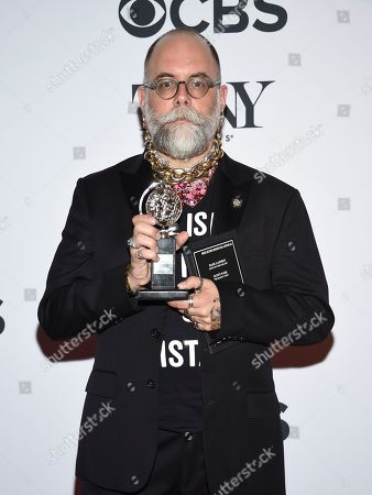 """David Zinn poses in the press room with the award for best scenic design of a musical for """"SpongeBob SquarePants:The Musical"""" at the 72nd annual Tony Awards at Radio City Music Hall, in New York"""