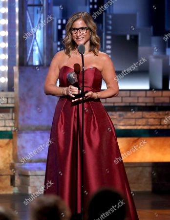 Melody Herzfeld, drama teacher at Marjorie Stoneman Douglas High School, accepts the award for excellence in theatre education at the 72nd annual Tony Awards at Radio City Music Hall, in New York