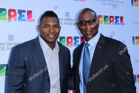 Yasiel Puig, Eric Dickerson. Yasiel Puig, left, and Eric Dickerson arrive at the Israeli Consulate in LA event to Celebrate the 70th Anniversary of Israel at Universal Studios, in Los Angeles