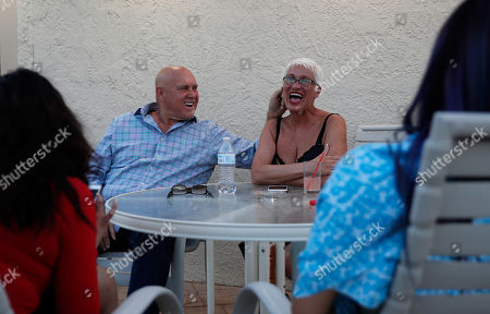 Owner Dennis Hof, left, jokes with madam Sonja Bandolik at the Love Ranch brothel in Crystal, Nev. A coalition of religious groups and anti-sex trafficking activists have launched referendums to ban brothels in two of Nevada's seven counties where they legally operate. Hof, a legal pimp challenging an incumbent Republican lawmaker Tuesday, June 12, says a push to ban legal brothels is political retribution