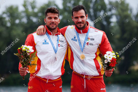 Saul Craviotto and Cristian Toro of ESP celebrate on the podium at the medal ceremony for the Men's Kayak Double (K2), 200m sprint race